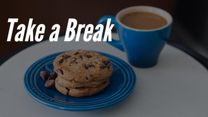 Picture of a tea cup and some biscuits with the text take a break